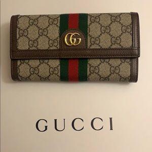Gucci Supreme Flap Wallet